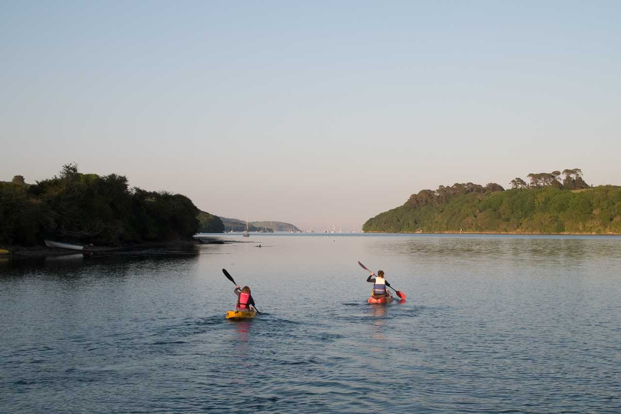 Kayaking family on the Helford River at Sunset